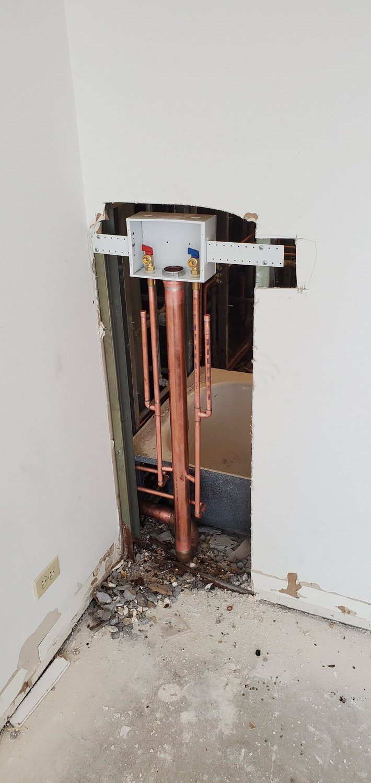 plumbing contractors at work