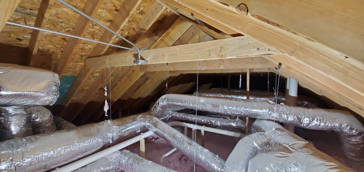 air conditioning installers at work