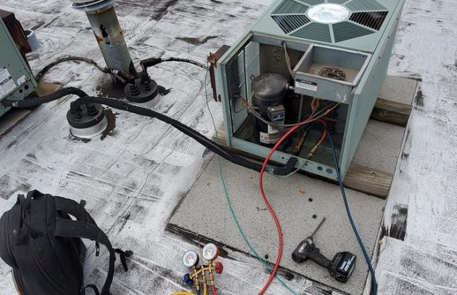 air conditioning contractor at work